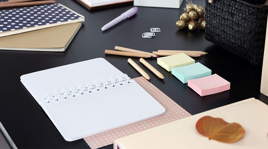 Careers desk with diary, post it notes and pencils