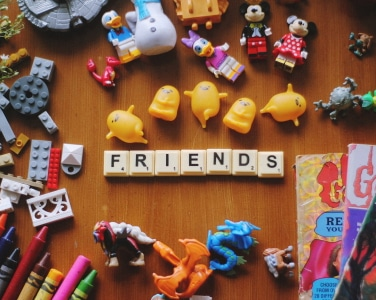 Kids toys, crayons, books and scrabble chips photo