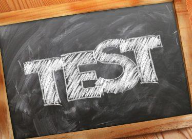 The word TEST written in chalk on chalkboard photo