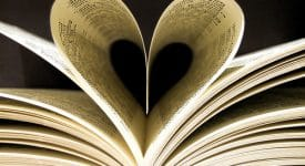Book pages folded in a heart shape