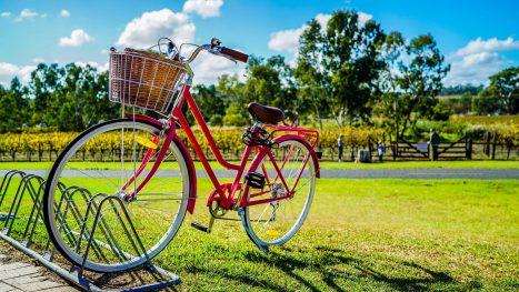 Red bike with basket in bike rack
