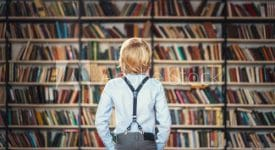 Photo of boy standing in library