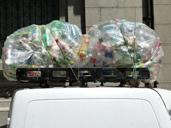 Photo of bagged bottles on car roof ready for recycling