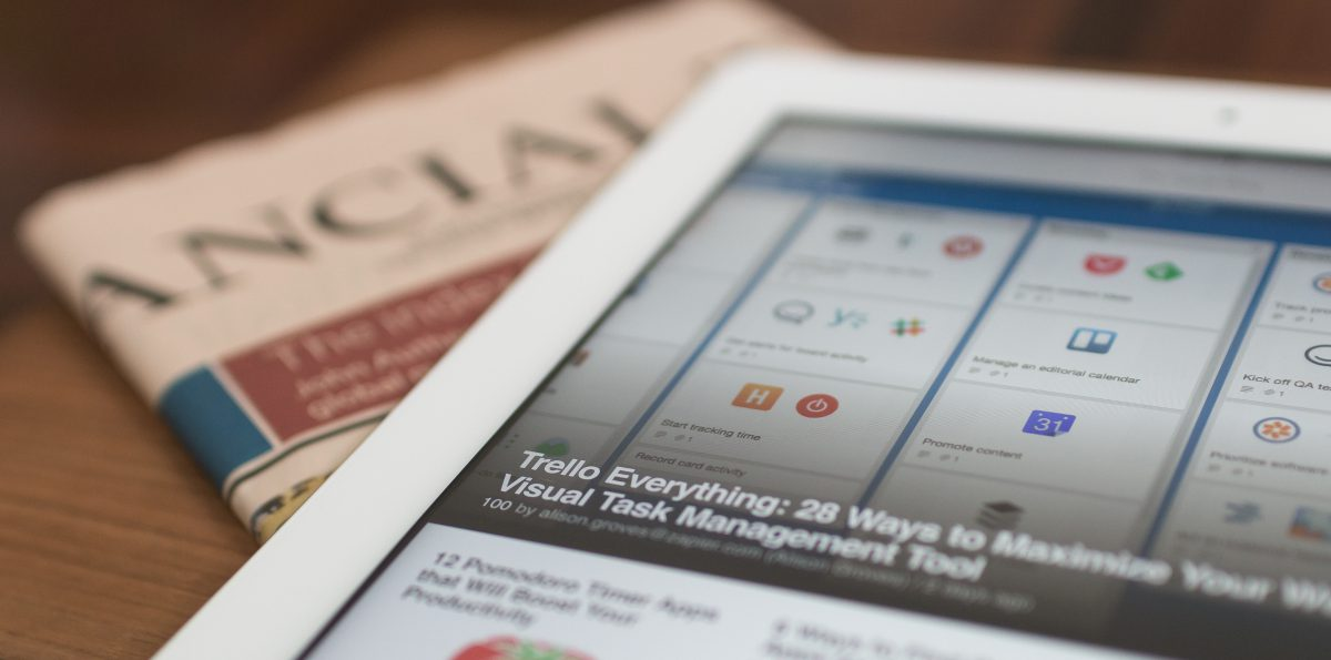 Reading Articles in Newspaper and on Device