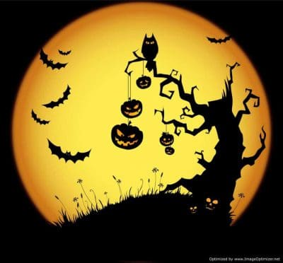 tree with pumpkins and full moon