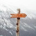 directional arrow on a wood post