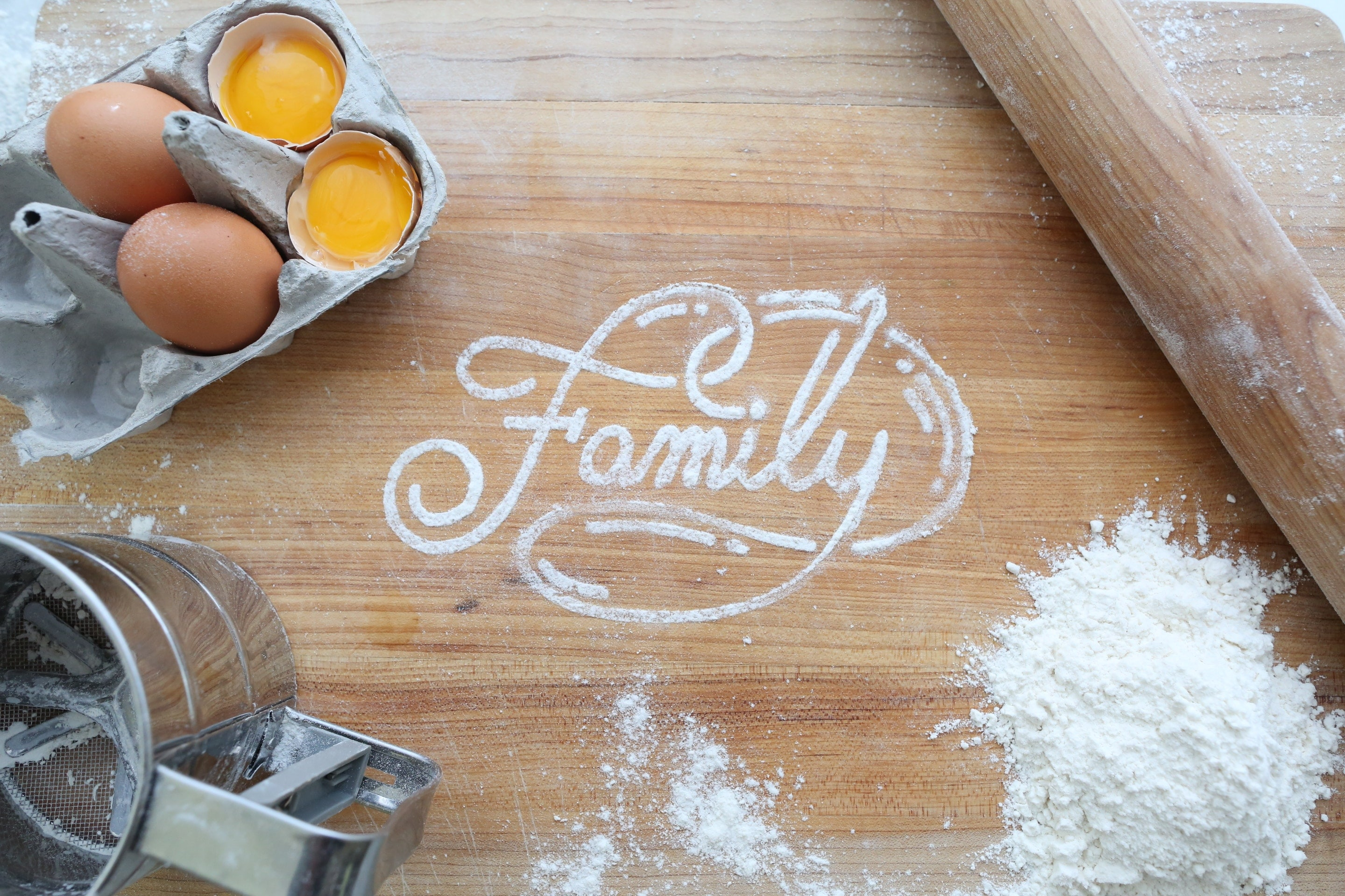 "Photo of Baking Ingredients with ""Family"" written in flour"