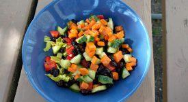 Healthy salad in blue ceramic bowl