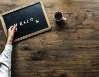 The word 'HELLO' written in chalk on a chalkboard
