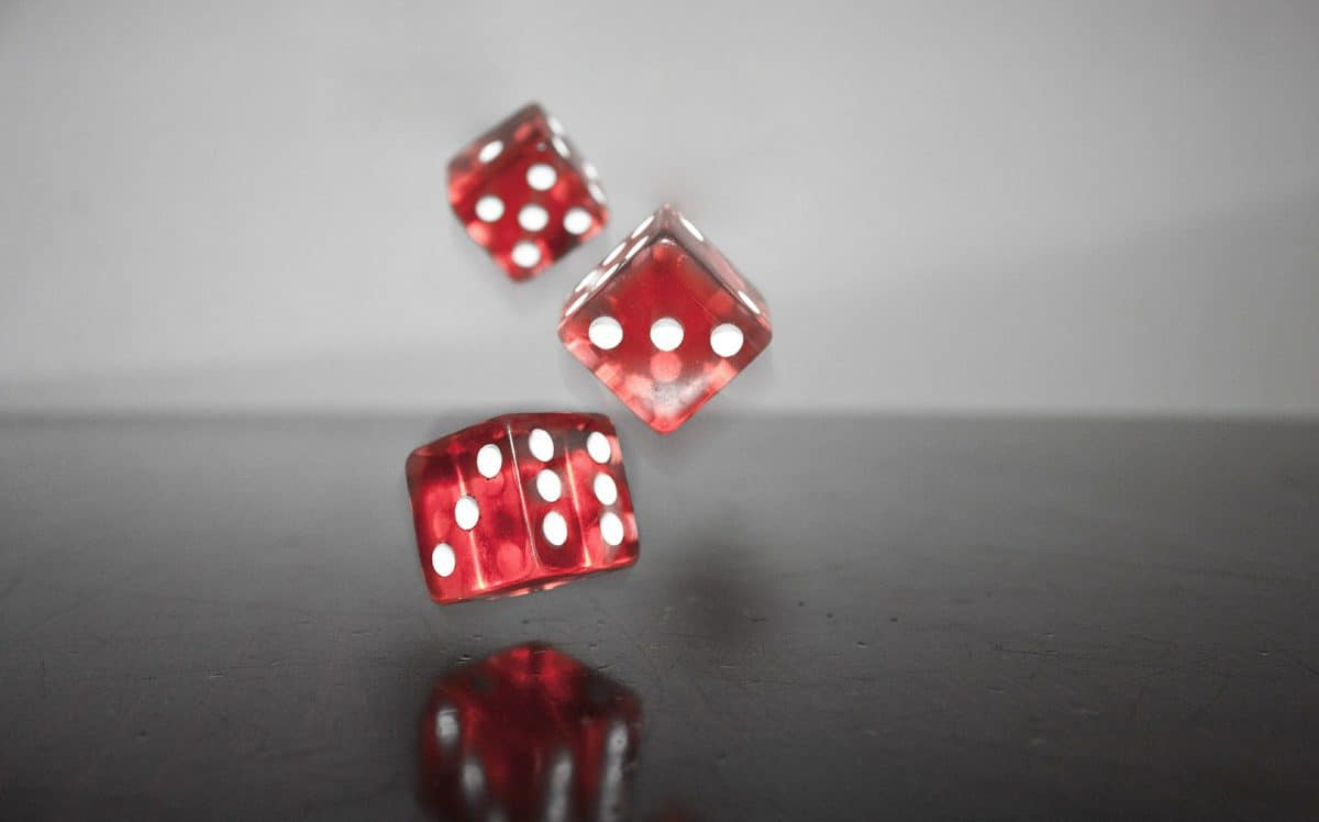 Photo of red dice bouncing on surface