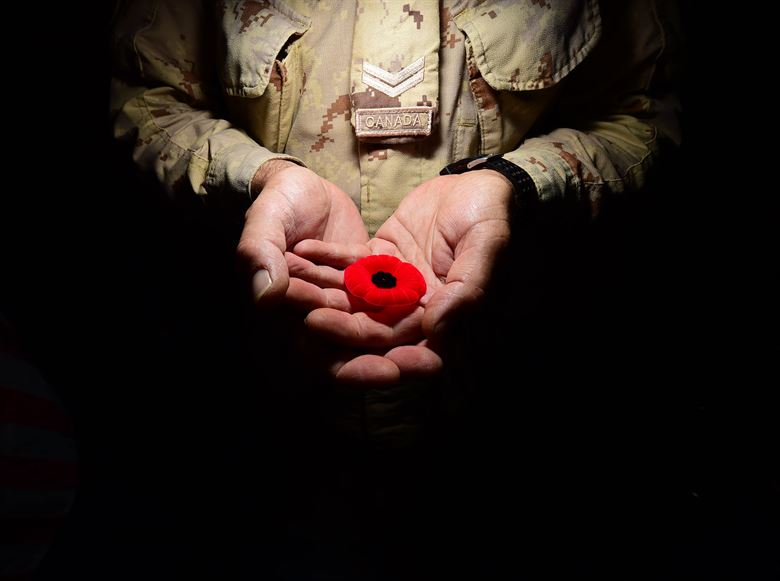 photo of soldier holding poppy
